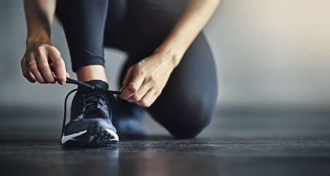 Woman putting on trainers