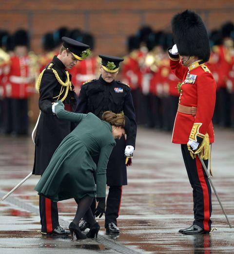 Footwear, Bearskin, Uniform, Headgear, Hat, Costume accessory, Tradition, Grenadier, Boot, Costume hat,