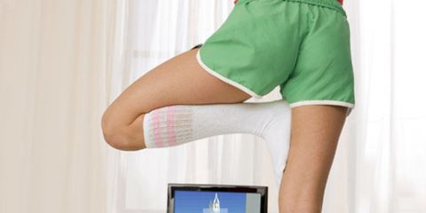 woman doing yoga on a wii fit