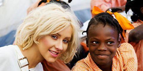 christina aguilera in haiti with a child
