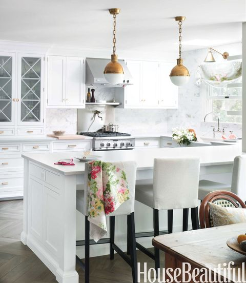 <p>Touches of brass: Hicks pendants from Circa Lighting, Boston Functional sconce by Visual Comfort, and Prestige Brass hardware. Henriksdal barstools by Ikea. Silestone countertops in Lagoon have the look of marble but are impervious to stains.</p>
