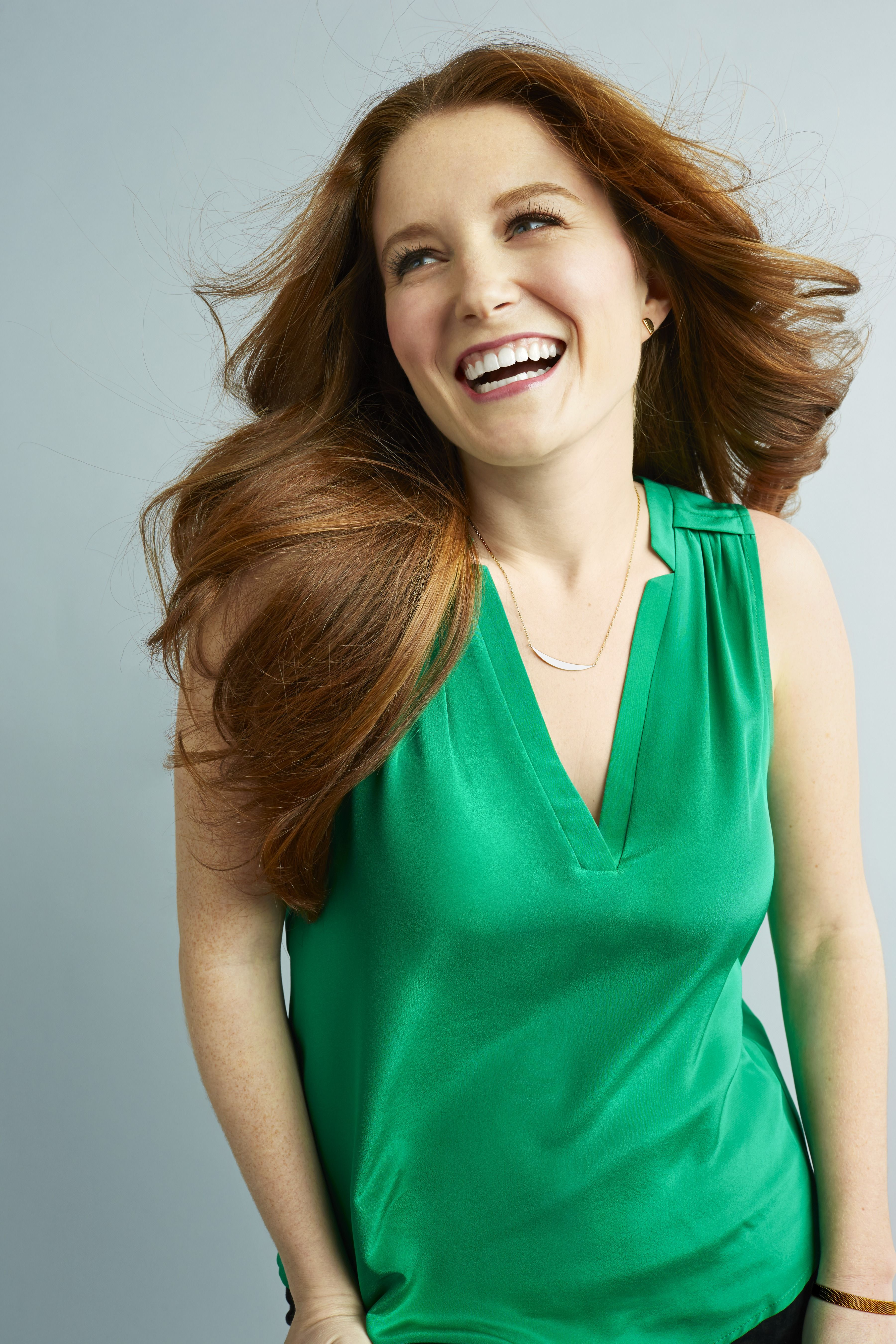 """""""Redheads sparkle in jewel tones,"""" says Trayce Field, costume designer on 2 Broke Girls.<em>This green reminds me of a ring I inherited from my grandmother. I've always loved how it looks against my skin.""""—Anna Clayton, 28</em>Earrings, $40&#x3B; <a href=""""http://www.gorjana.com/jewelry/earrings/luna-shimmer-studs.html"""">gorjana.com</a>. Top, Amanda Uprichard, $172&#x3B; <a href=""""http://www.zappos.com/"""">zappos.com</a>. Necklace, $35&#x3B; <a href=""""http://earthychic.net/collections/redbook-moon-march-2015/products/crescent-half-moon-necklace"""">vearthychic.net</a> (20% off with code REDBOOK20)."""