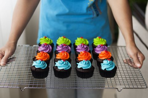 Finger, Sweetness, Cupcake, Food, Dessert, Baked goods, Nail, Cuisine, Baking cup, Cake decorating supply,