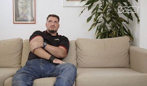 Human, Comfort, Sitting, Denim, Facial hair, Interior design, Couch, Living room, Furniture, Wall,