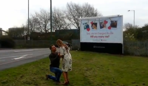 Romantic boyfriend surprises partner by writing his proposal on a giant billboard that she passes on her way to work