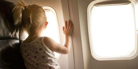 Toddler kicked off plane