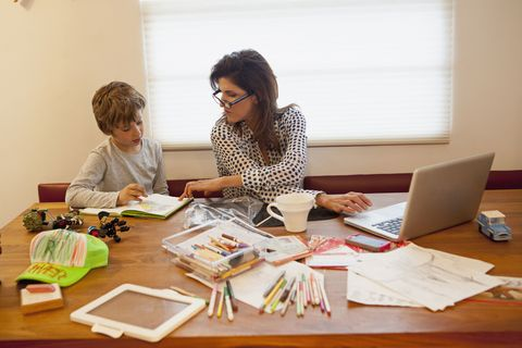 Working mom with son at table