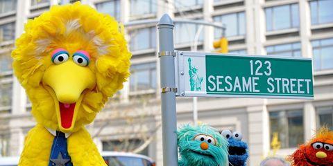 Signage, Toy, Sign, Street sign, Beak, Teal, Aqua, Turquoise, Fictional character, Plush,