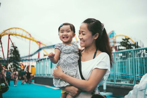 Mother and baby at amusement park