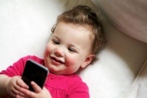 Finger, Cheek, Eyebrow, Hand, Child, Mobile phone, Baby & toddler clothing, Communication Device, Toddler, Telephony,