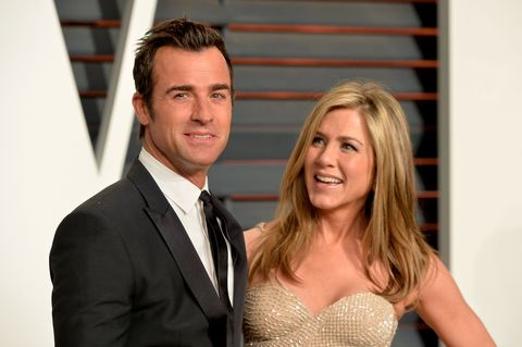 Jennifer Aniston and Justin Theroux pose on red carpet