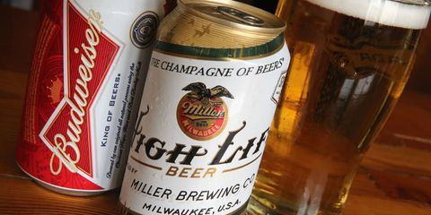 Beverage can, Aluminum can, Barware, Beer glass, Tin can, Alcohol, Drink, Alcoholic beverage, Amber, Logo,