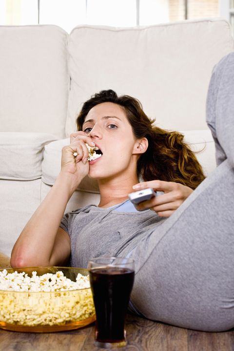 Drink, Kettle corn, Popcorn, Tableware, Comfort, Alcoholic beverage, Drinkware, Drinking, Couch, Food craving,