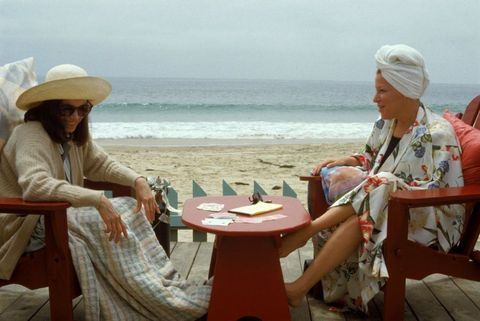 Leisure, Outdoor furniture, Table, Outdoor table, Sitting, Tourism, Hat, Headgear, Vacation, Sun hat,