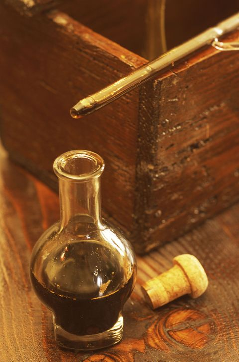 Wood, Bottle, Liquid, Glass bottle, Hardwood, Drinkware, Wood stain, Still life photography, Ingredient, Distilled beverage,