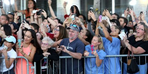 Hair, Face, Arm, Product, People, Crowd, Social group, Hand, Audience, Celebrating,