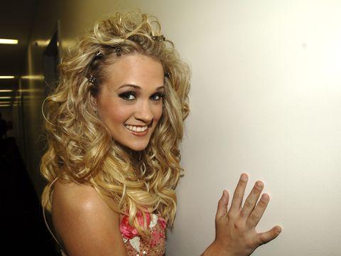 Nose, Finger, Facial expression, Wrist, Eyelash, Nail, Blond, Gesture, Thumb, Long hair,