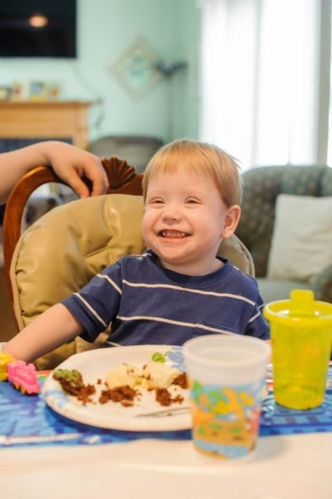 Smile, Child, Tableware, Meal, Toddler, Sharing, Living room, Sitting, Couch, Cuisine,