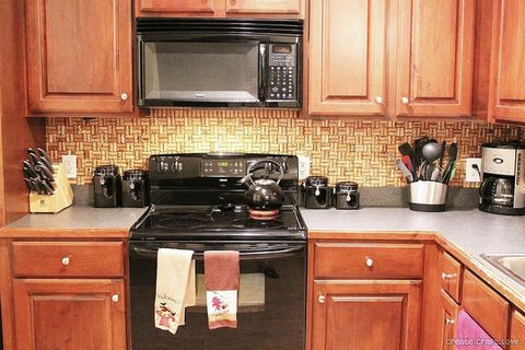 Room, Wood, Property, Major appliance, Kitchen, Home appliance, Kitchen appliance, Stove, Cabinetry, Wood stain,