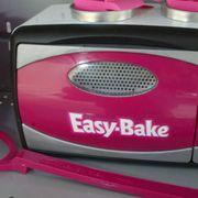 Automotive exterior, Pink, Magenta, Plastic, Bumper, Circle, Machine, Baby toys, Loudspeaker,