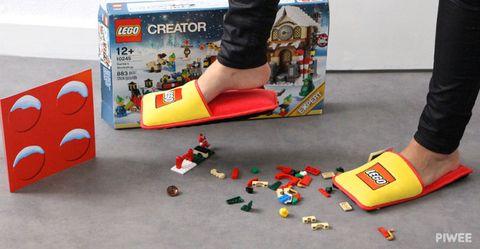 Human leg, Toy, Carmine, Foot, Advertising, Sock, Ankle, Plastic, Walking shoe, Games,