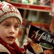 Child, Junk food, Headgear, Smile, Snack, Knit cap, Cuisine, Cap,