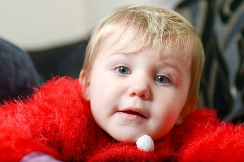 Lip, Cheek, Skin, Eyebrow, Textile, Red, Child, Baby & toddler clothing, Eyelash, Iris,