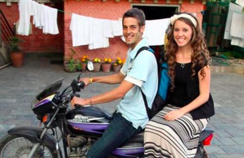 Motorcycle, Smile, Happy, Fender, Automotive tire, Travel, Motorcycle accessories, Flag, Houseplant, Flowerpot,