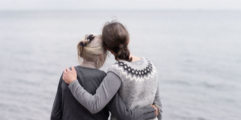 Mother and daughter in gray sweaters