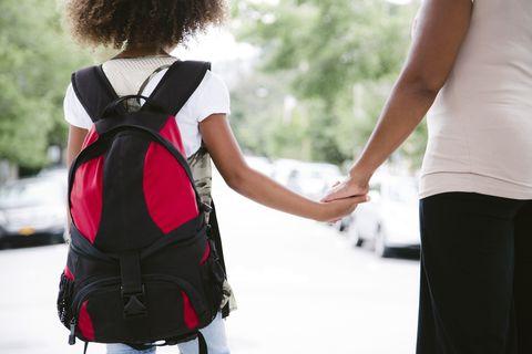 Mom walking kid to school