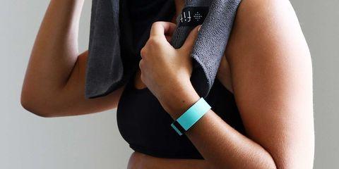 Woman wearing Fitbit fitness tracker wristband