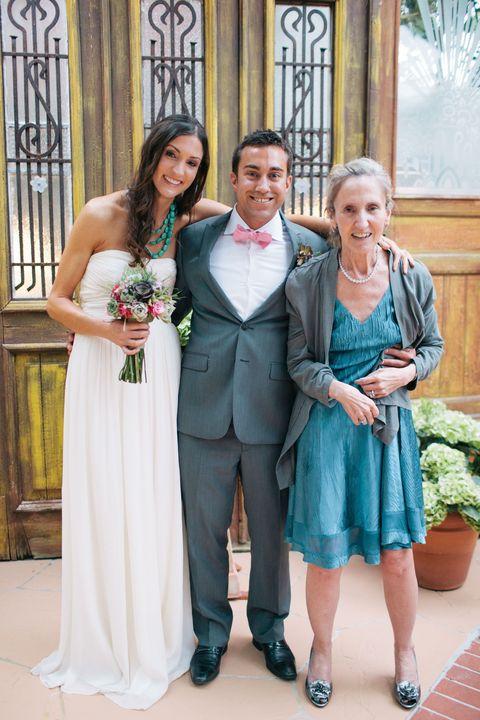 Clothing, Smile, Dress, Coat, Trousers, Flowerpot, Shirt, Photograph, Outerwear, Bridal clothing,