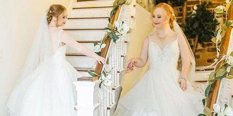 Clothing, Bridal clothing, Dress, Sleeve, Shoulder, Bridal accessory, Textile, Gown, Photograph, Wedding dress,