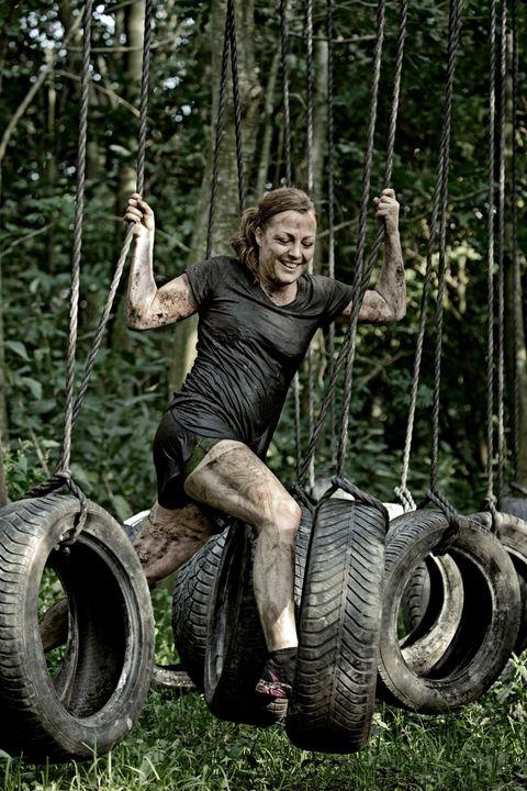 Human, Automotive tire, Shoe, Swing, Public space, Leisure, Automotive wheel system, Iron, Physical fitness, Tread,
