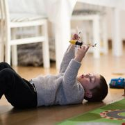 Leg, Joint, Physical fitness, Room, Arm, Flooring, Floor, Child, Photography, Sitting,