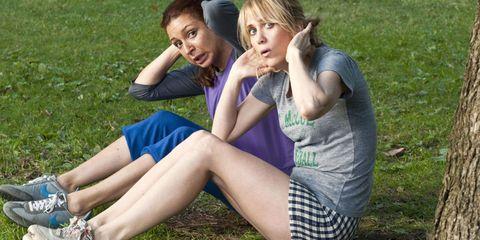 Leg, Grass, Shoe, Human leg, Sitting, People in nature, Athletic shoe, T-shirt, Summer, Knee,