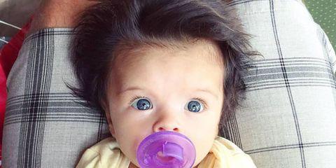 Cheek, Skin, Child, Baby & toddler clothing, Eyelash, Toddler, Black hair, Baby, Baby Products, Baby grabbing for something,