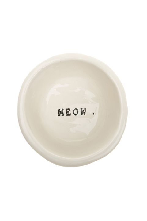 "<p>The only word in your cat's vocabulary needs to be in the place that matters most: the food bowl. This ceramic bowl is dishwasher safe and features the cutest fishbone illustration on the side. <em>$25, </em><a href=""http://us.mungoandmaud.com/Cats/Cat-Bowls/Cat-Bowl-Meow/2614/"" target=""_blank""><em>mungoandmaud.com</em></a><br></p>"