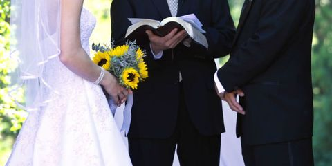 Clothing, Blue, Finger, Yellow, Coat, Trousers, Suit trousers, Hand, Bouquet, Standing,