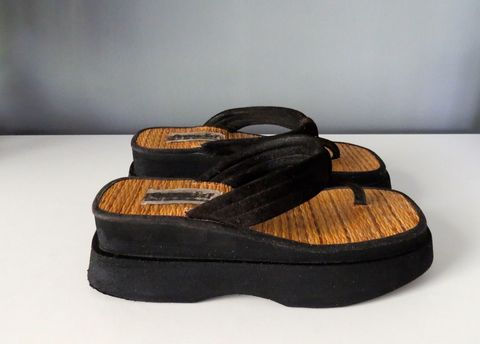 """<p>These were lined with the same material as a woven straw beach mat. You still have no idea why. </p><p><em><a href=""""http://www.ebay.com/itm/On-Your-Feet-by-Chinese-Laundry-Vintage-90s-Platform-Flip-Flop-Sandals-Size-6-/112048495497?hash=item1a169c5b89:g:p8wAAOSwn9lXLN71"""">Ebay</a></em></p>"""