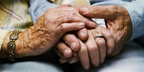 senior couple holding hands old love marriage