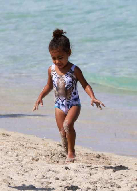 <p>The fashionable toddler had the Miami Beach look on lock this weekend with this adorable tiger swimsuit. </p>