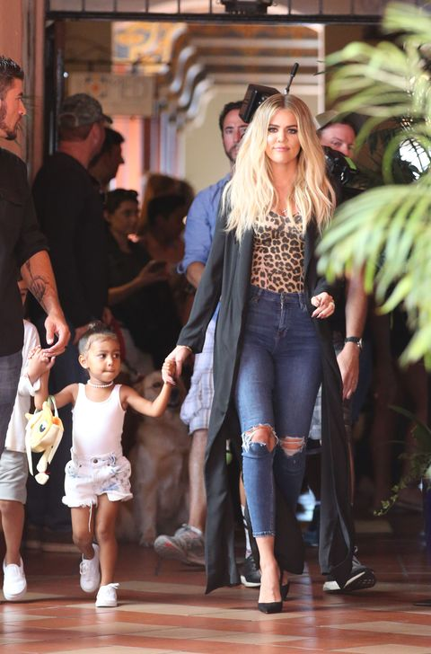 <p>Who wants a cat purse now? Giving her Fallon chokers a break, North goes for a string of pearls and denim cutoffs.</p>