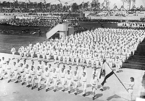 """<p>Due to World War I, the year's Games — which were scheduled to be in Berlin —<span class=""""redactor-invisible-space""""></span> were canceled. Yet, in true Olympics fashion, a stadium was planned years in advance before this decision was made (this 1913 parade dedicates the very structure). This won't be the first time the games aren't held due to war, either. Both the Summer and Winter Games in 1940 and 1944 were canceled in light of World War II. </p><p><em>Photo via </em><a href=""""http://loc.gov/pictures/resource/ggbain.13627/"""" target=""""_blank""""><em>Library of Congress</em></a></p>"""