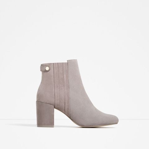 "<p>$89.90; <a href=""http://www.zara.com/us/en/woman/shoes/boots-and-ankle-boots/elastic-split-suede-ankle-boots-c665040p3610290.html"" target=""_blank"">Zara</a></p>"