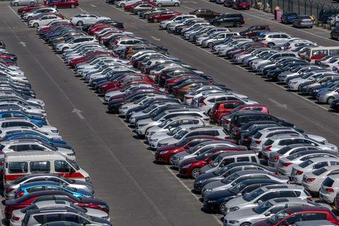 Motor vehicle, Mode of transport, Automotive design, Vehicle, Automotive parking light, Automotive exterior, City, Parking lot, Automotive lighting, Public space,