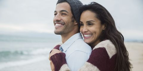 Smile, Sleeve, Textile, Happy, Facial expression, Sweater, Tourism, Interaction, Vacation, Tooth,