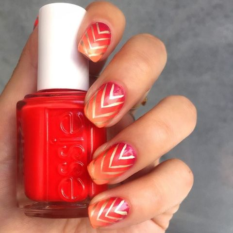 "<p>Metallic lines help neutralize the fiery bold colors in <a href=""https://www.instagram.com/p/BGFY4YklKRL/"" target=""_blank"">this sunset-inspired mani</a>.</p>"