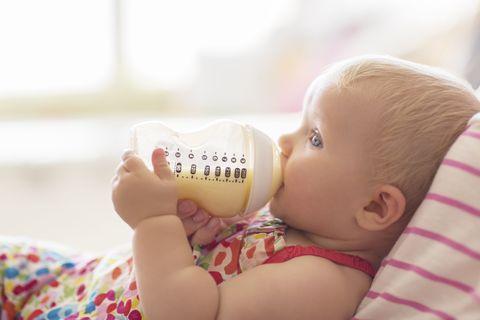 Baby bottle, Skin, Milk, Plastic bottle, Child, Baby & toddler clothing, Baby bottle feeding, Baby Products, Drink, Nail,
