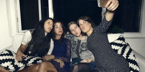 youngish women taking selfie